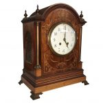 A mahogany inlaid clock dial inscribed 'S. Smith & Son LTD. 104 Strand London', mechanism marked 'Rack French make 13771 6'