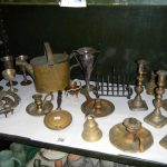 A mixed lot of brass ware including candlesticks, one shelf