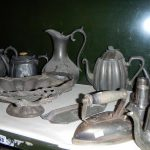 A mixed lot of metal ware including pewter, one shelf