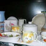 A mixed lot of china including cake stands, one shelf