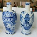 "A large pair of rare shaped 19th century blue and white vases depicting a large house, stream and boats, having a 4 character blue Kangxi mark to base, approximately 14"" tall"