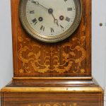 An Early French inlaid mantel clock marked Laine, Paris. In working order
