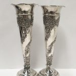A pair of decorative silver vases London 1921 WC. 1 has solder repair to base