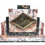 An art Nouveau onyx/marble clock
