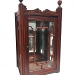 A small astragal glazed cabinet with bevelled mirror back