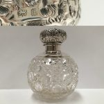 A hobnail cut slver topped scent bottle H.M. 1923