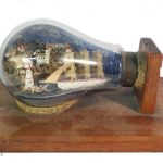 miniature scene in lightbulb