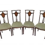 A set of 4 Edwardian mahogany inlaid chairs in need of attention