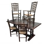 An oak dining table and 6 chairs