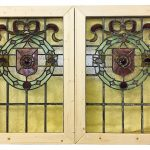 A pair of Victorian stained glass windows with 6 spare pieces. 80.5cm x 56.5cm with frame