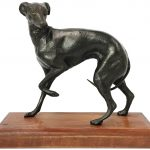 A bronze Whippet on wood base