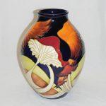 A Moorcroft 'Parasol Dance' vase. A design by Kerry Goodwin