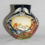 A Moorcroft 'While Shepherds Watched' vase. A design by Kerry Goodwin