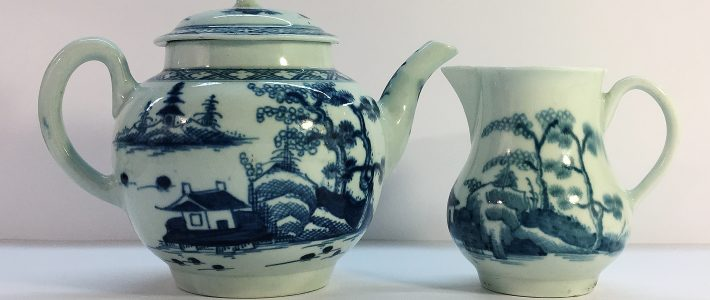 An 18th Century blue and white willow pattern teapot - Possibly Bristol of Bow and a similar milk jug