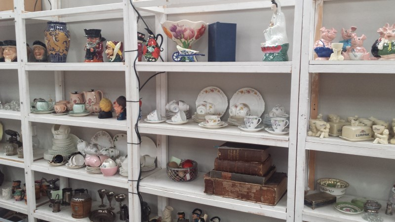 antique general auction display including toby jugs