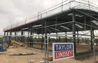 New Building Coming Along Well as Unique Auctions Expansion Continues