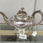 An ornate 19th century silver teapot
