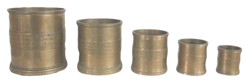 George IV A composite set of five brass graduated measures with lincoln mayor details